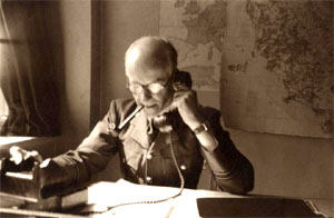 Photograph of Bertram Rota whilst working at the Photographic Reconnaissance Interpretation Unit at Medmenham.