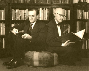 Photograph of Bertram and Anthony Rota reading.